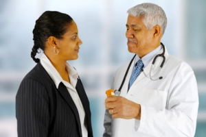pharmacist talking to his customer